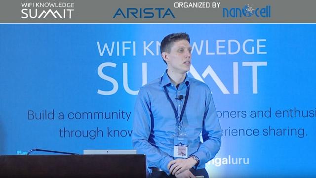 Discorso di Colin McGuire al WiFi Knowledge Summit sulla modellazione dei standard IEEE 802.11ax